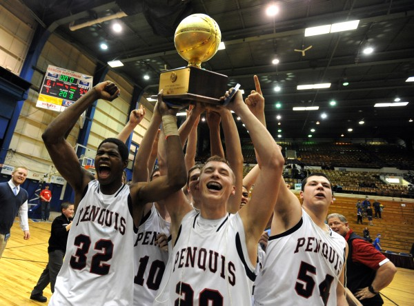 Isaiah Bess (from left), Trevor Lyford and Justin Larry, along with the rest of the Penquis Valley Patriots, carry their gold ball for fans after their 61-54 victory over Boothbay Regional High School at the Class C boys state championship at the Bangor Auditorium in March.