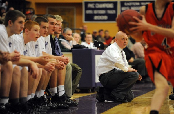 Hampden head basketball coach Russell Bartlett coaches from the sideline against Brewer on Thursday at Hampden.