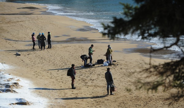 Polar dippers and observers prepare to leave Sand Beach in Acadia National Park after a morning of brief swims in the Atlantic Ocean on Jan 1, 2014.