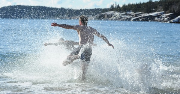 Two men throw themselves into the Atlantic Ocean for a polar dip in the waters off Sand Beach in Acadia National Park on Jan 1, 2014.