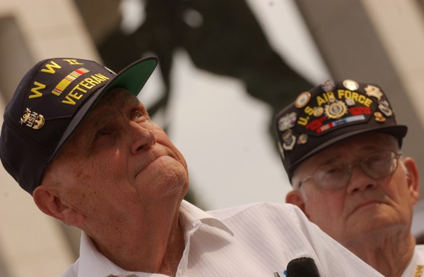 World War II veteran Bill Knight and Korean War veteran Harold Hansen participate in a ceremony with 140 veterans, Maine Troop Greeters and community members on Sept. 23, 2005, at the World War II Memorial in Washington.