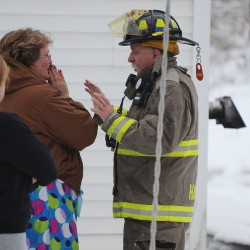 "<a href=""http://bangordailynews.com/video/fire-leaves-hampden-family-homeless/?ref=search"">Phillipa Gilmore</a> (center) talks with Lt. Frank Coombs about the fire in the house at 40 Main Road South in Hampden where she escaped along with her 13-year-old daughter on Monday afternoon. Listening in is neighbor Allyson Mitchell (left). A pet guinea pig was saved, but an exotic bird did not survive and a cat is still missing."