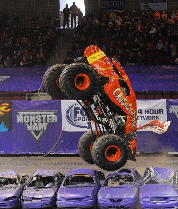 Greg Winchenbach gets some air Saturday afternoon in his Crushstation truck during the wheelie competition of the Monster Jam at the Cross Insurance Center in Bangor.