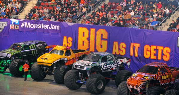 Trucks line up for the competition Saturday during the Monster Jam at the Cross Insurance Center in Bangor.