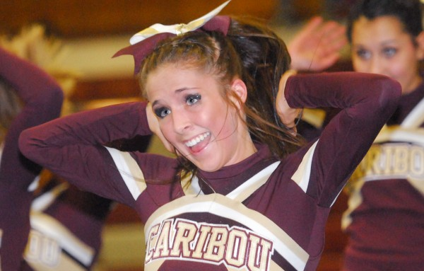 Caribou High School cheerleader Melanie Biggs competes with her team at the PVC Class B Cheering Competition at Mattanacook Academy in Lincoln on Saturday.