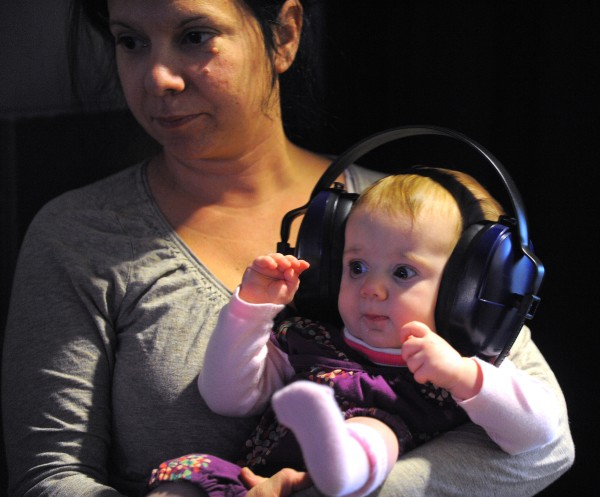 Nicole Steele of Cumberland watches the Monster Jam with her 6-month-old daughter Grace at the Cross Insurance Center in Bangor.