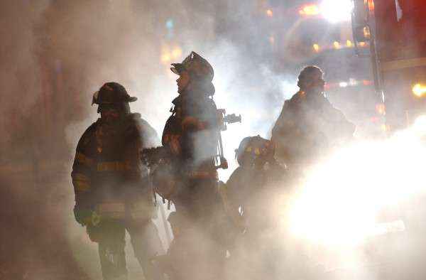 Firefighters from Bangor and Brewer are shrouded in water vapor and smoke as they respond to a blaze at the former Masonic Hall on Main Street in downtown Bangor in January 2004.