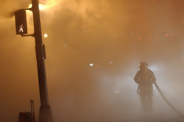 A Bangor firefighter is shrouded in water vapor rising off the pavement after  Bangor and Brewer firefighters responded to the January 2004 fire at the former Masonic Hall in Bangor.