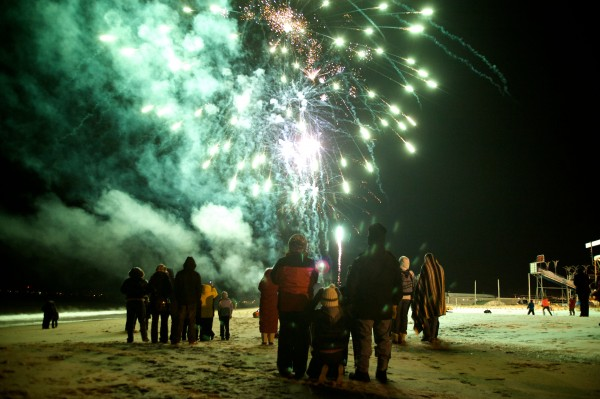 Revelers watch fireworks on the sand in Old Orchard Beach Tuesday night as temperatures plunged into single digits. Community and business group OOB365 sponsored the New Year's Eve event.