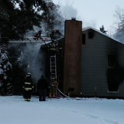 Home fire in Orrington closes road, displaces family of five
