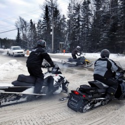 Snowmobile therapy: Disabled veterans hit trails, mountains