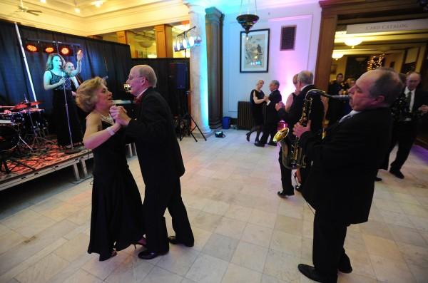 Al Bernardo saxophone player with The Waiters, a  Portland-based band, plays in the middle of the dance floor at the Bangor Public Library during the BDN Maine New Year's Eve Gala on Tuesday.