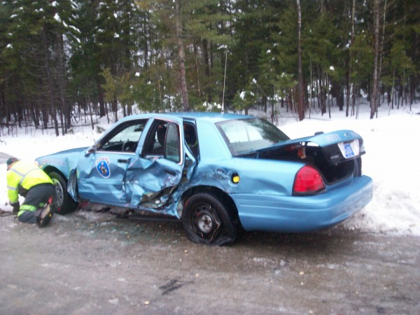 A state police cruiser was struck by a tractor-trailer on Interstate 95 in northern Penobscot County Monday morning. The trooper was not injured.
