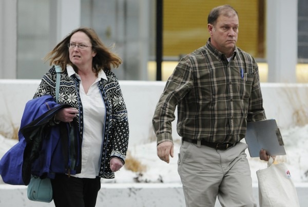 Malcolm French and his wife, Barbara, leave federal court in Bangor on Tuesday.