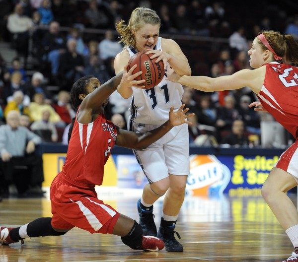 Liz Wood of the University of Maine has the ball stripped from her by Stony Brook's Jessica Ogunnorin (left) and Kim Hanlon at the Cross Insurance Center on Sunday.