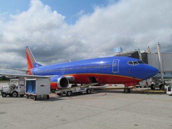 A Southwest passenger jet sits at a terminal at Portland International Jetport in late August.