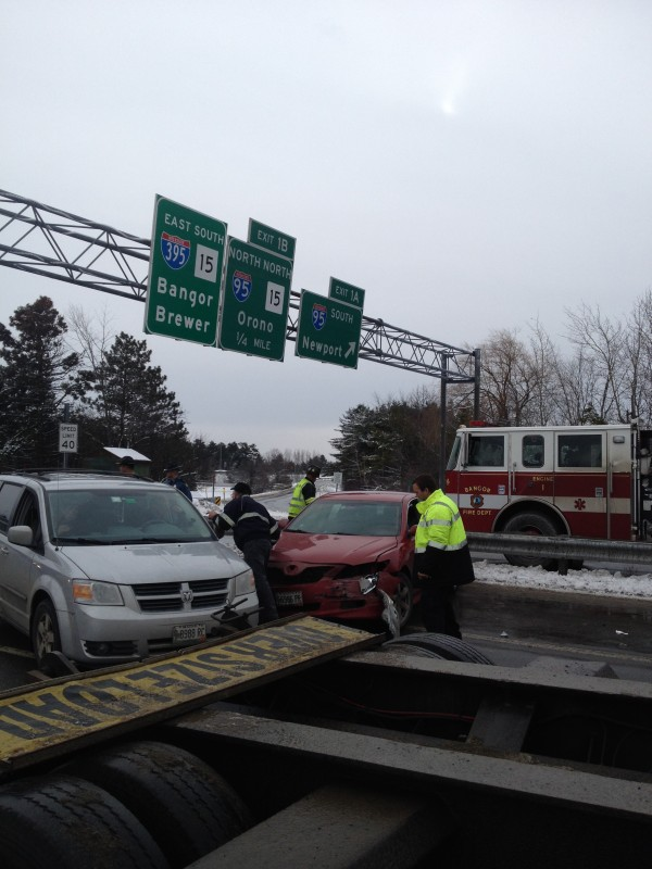 Crews prepare to remove a pair of vehicles from the westbound lanes of Interstate 395 after an accident near Odlin Road Monday morning. No serious injuries were reported.