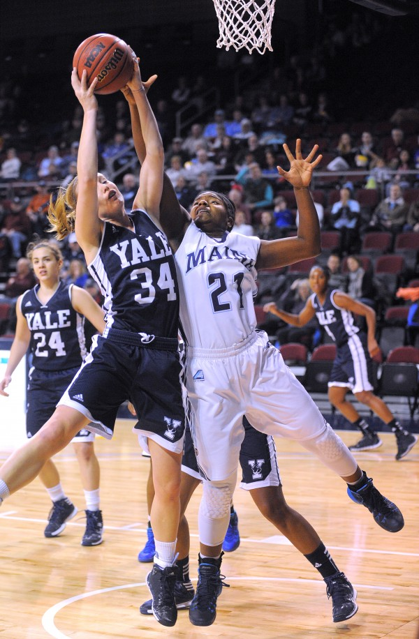Yale University's Janna Graf (left) and the University of Maine's Sheraton Jones battle for a rebound during their game at the Cross Insurance Center in Bangor Sunday.