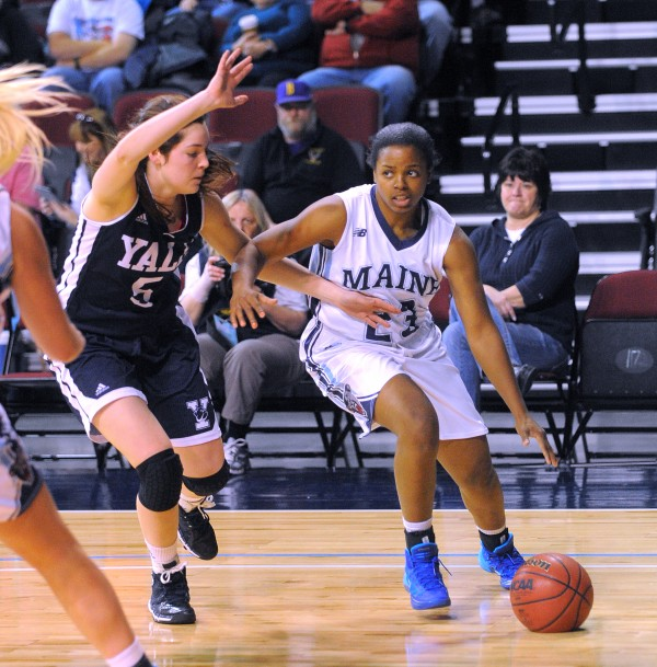 The University of Maine's Ashleigh Roberts (right) drives past Yale University's Katie Werner during their game at the Cross Insurance Center in Bangor Sunday.