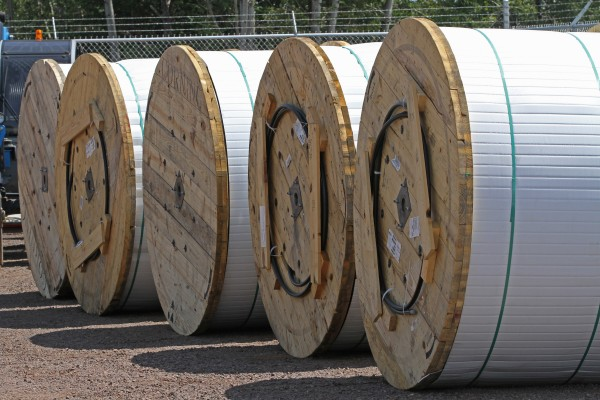 Giant rolls holding fiber optic cable are stored at a Lake Connections construction yard, waiting to be installed as a part of a broadband project in northern Minnesota, July 31, 2012. By the time the communications project is done in 2014 around 2000 miles of fiber optic cable will be strung, connecting customers with broadband internet, video and telephone service.
