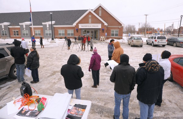 About 30 people participated in a demonstration at the Waterville Police Department to press for prosecution in the case of Ayla Reynolds, the toddler who has been missing since December 2011.