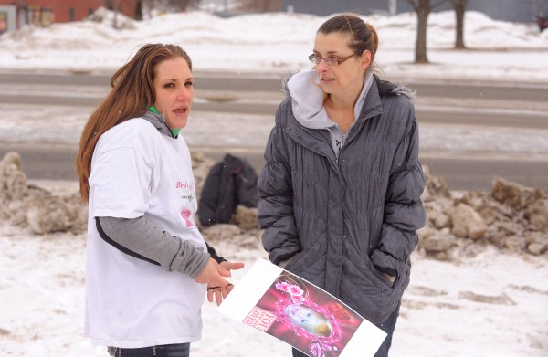 Trista Reynolds (left), mother of missing toddler Ayla Reynolds, talks to Heather Garczynski of Erie, Pa., during a demonstration at the Waterville Police Department to press for prosecution in the case of the missing toddler. Garczynski was one of the organizers of the event and drove to Maine with several friends to participate.