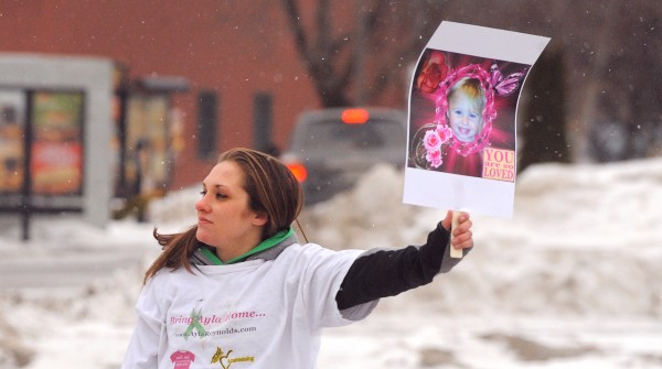 Trista Reynolds, mother of missing toddler Ayla Reynolds, was among the people who participated in a demonstration at the Waterville Police Department to press for prosecution in the case of the missing toddler.