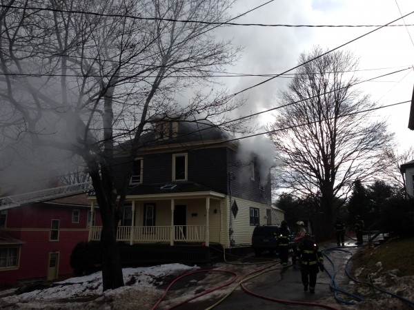 Fire crews work to put out a house fire at 40 Dillingham Street Friday afternoon in Bangor.