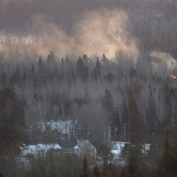 Evacuation ordered as train carrying crude oil derails, catches fire in New Brunswick