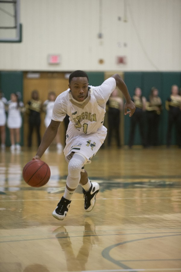 Husson University's Corey Wood drives to the basket on Dec. 3, in Bangor.