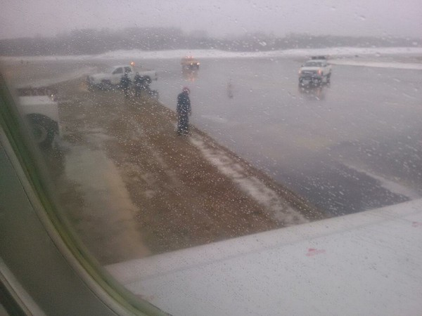 This is the view from a passenger plane at Bangor International Airport that slid off the runway Saturday afternoon. No one was injured in the plane mishap. The Canadair regional jet had just landed and was on taxiway K at about 1 p.m. when the jet's nose wheel lost its traction, said Airport Director Tony Caruso, who estimated that the plane was a 50-passenger jet.