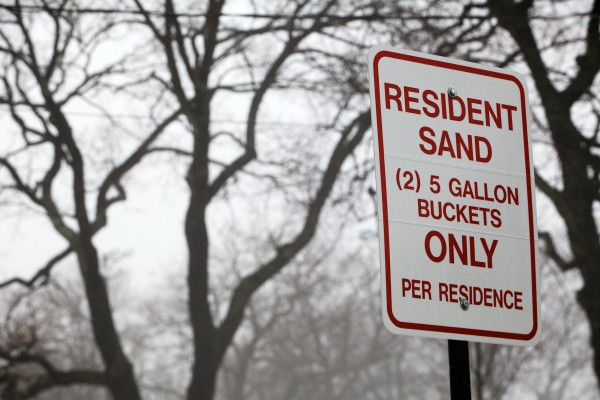 A sign over the public sand pile in Portland's Deering Oaks Park states the rules.