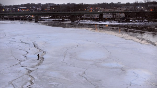 A man tries his luck catching smelts on the ice of of the Penobscot River about 25-30 yards from the Brewer shore Saturday afternoon. The man didn't want to be identified, but he said he didn't catch anything. He measured the ice where he was fishing and it was 16 inches thick.