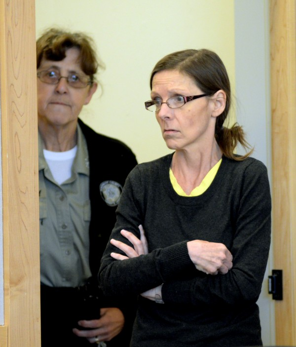 Roxanne Jeskey, 50, enters a courtroom at the Penobscot Judicial Center Thursday morning.  Jeskey, who is accused of brutally slaying her husband Richard Jeskey 2 1/2 years ago, will likely take the stand in her defense when her murder trial resumes next week.