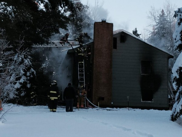 Crews battle a fire at a Clark Falls Road home in Orrington on Wednesday.