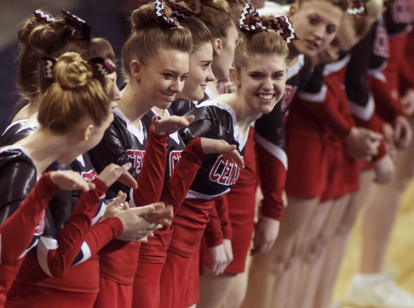 The Central High School girls await their introduction for their performance in the  Class C cheering competition at the Cross Insurance Center in Bangor on Saturday. The Red Devils won the Eastern Maine Class C event.