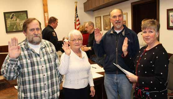 Three new Dexter Town Councilors were sworn in Jan.9 by Town Clerk Kim Hughes. Pictured, from left, are Mark Robichaud, Sharon Grant, Ron Apel and Hughes.