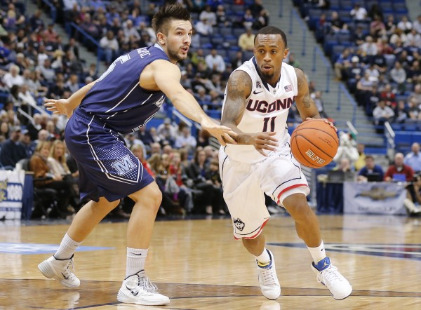 Zarko Valjarevic (left) of the University of Maine, pictured in a Dec. 6, 2012, game at Connecticut, hit six 3-pointers and scored 24 points Saturday in the Black Bears' 79-76 America East basketball loss to Maryland Baltimore County.