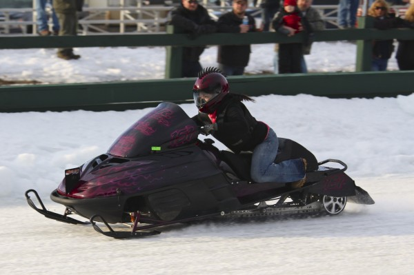 Rene Fischer, a racer from Sandown, N.H., speeds along the Katadhin Area Snowmobile Racing Affiliates ice dragway in Medway on Jan. 18 for the Northeast Winter Nationals Snowmobile Ice Drag Races.