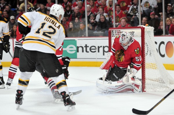 Chicago Blackhawks goalie Corey Crawford (50) makes a save against Boston Bruins right wing Jarome Iginla (12) during the third period at the United Center in Chicago Sunday. The Blackhawks beat the Bruins 3-2 in a shootout.
