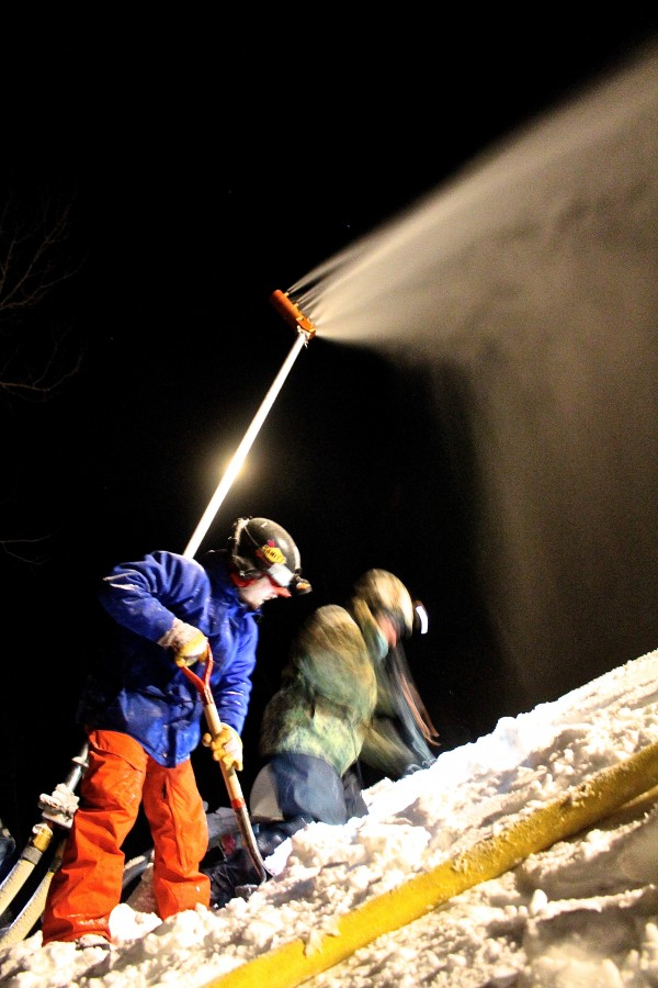 Caleb Dilworth (right), 25, of Greenbush and Aaron Obrien, 35, of Burnham clear snow away from a snow gun beside a ski trail on Sugarloaf Mountain on Jan. 9.