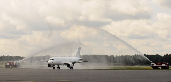 The first Allegiant Air Airbus aircraft that landed at the Bangor International Airport receives a water salute in July morning.