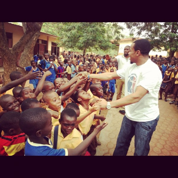 Former University of Maine football player and master's degree candidate Roosevelt Boone of Washington, D.C., is greeted by children at the Presbyterian Secondary School in Acraa, Ghana, during his visit there in 2012.