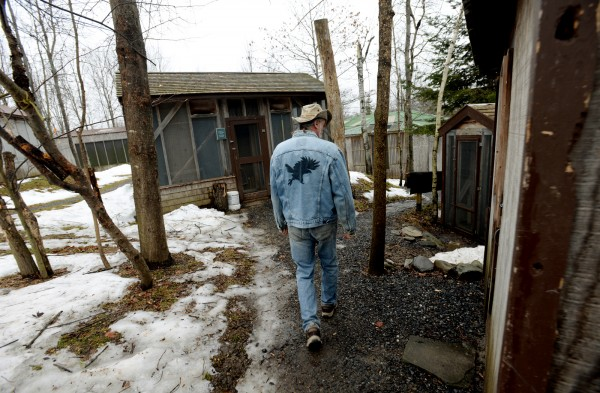 Marc Payne walks to the raptor compound at Avian Haven, a nonprofit wild bird rehabilitation center, in Freedom.