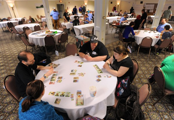 People play board games during the sixth annual SnoCon Gaming Convention in Orono on Saturday.