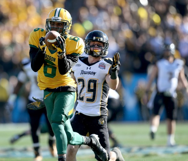 North Dakota State Bison cornerback CJ Smith (6) makes an interception in front of Towson Tigers wide receiver Brian Dowling (29) in the first half of the FCS National Championship game at Toyota Stadium in Frisco, Texas, Saturday. North Dakota State defeated Towson, 35-7.