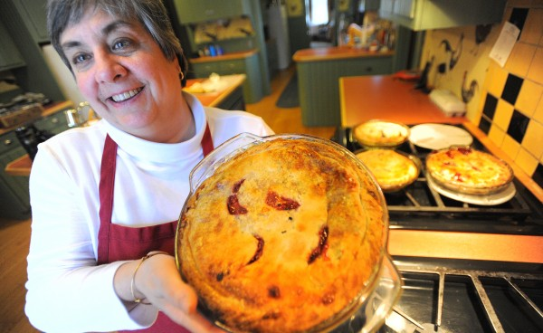 Cheryl Michaelsen, the co-owner of the Berry Manor Inn in Rockland, shows a completed pie.
