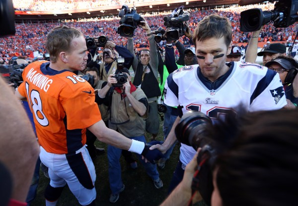Denver Broncos quarterback Peyton Manning (18) and New England Patriots quarterback Tom Brady (12) shake hands after the AFC championship game Sunday at Sports Authority Field in Denver.