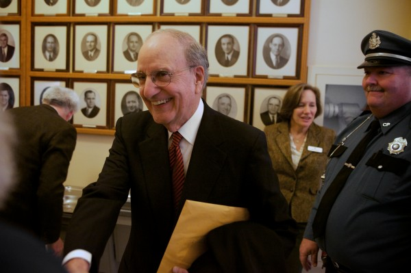 Former U.S. Sen. George J. Mitchell greets people in hallways of the State House in Augusta on Tuesday before before addressing a joint session of the legislature.
