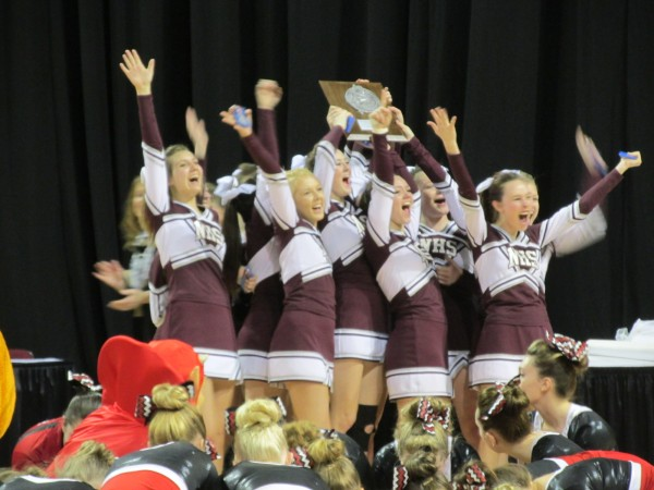 The Narraguagus High School cheerleading squad shows off its plaque to the crowd Saturday after posting a runner-up finish in the Eastern Maine Class C cheerleading championship at the Cross Insurance Center in Bangor.